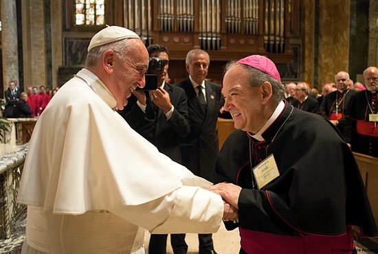 Archbishop Bernard Hebda, apostolic administrator of the Archdiocese of St. Paul and Minneapolis, greets Pope Francis Sept. 23 after midday prayer with U.S. bishops at St. Matthew's Cathedral in Washington, D.C. L'Osservatore Romano