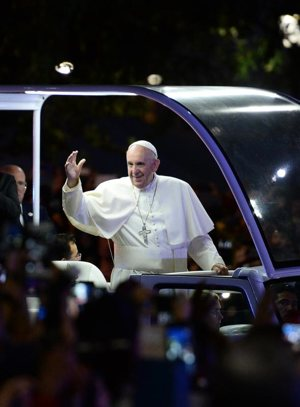 Pope Francis waves as he rides in his popemobile down Benjamin Franklin Parkway to the Festival of Families during the World Meeting of Families in Philadelphia Sept. 26. CNS photo/Jewel Samad, pool