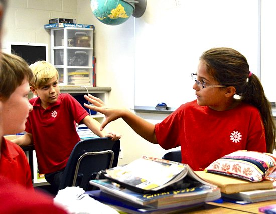 Fourth-grader Maggie Kramer joins a class discussion at St. Michael School in St. Michael. Bob Zyskowski/The Catholic Spirit
