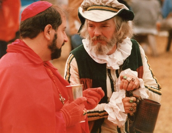 Father James Zappa, left, playing the role of a medieval cardinal, talks with a fellow actor at the Minnesota Renaissance Festival. Father Zappa, who was handy with a sewing machine made his own costume for the role, which he played at the Shakopee venue from 1987 to 2006. The recently retired pastor of Mary, Mother of the Church in Burnsville died Nov. 5.
