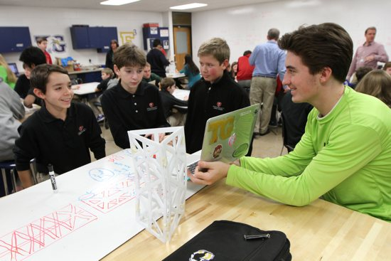 Totino-Grace High School senior John Wander, right, helps Frassati Catholic Academy seventh-graders Nicholas Gambeski, left, Jack Gorman and Conor Cooper with an engineering project during a visit Frassati students made to T-G to learn about the Engineering Institute. Dave Hrbacek/The Catholic Spirit