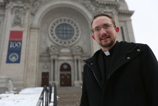 Father Michael Johnson, judicial vicar of the Metropolitan Tribunal of the Archdiocese of St. Paul and Minneapolis, stands outside the Cathedral of St. Paul, where tribunal staff will be available Ash Wednesday to answer questions about the annulment process. Dave Hrbacek/The Catholic Spirit