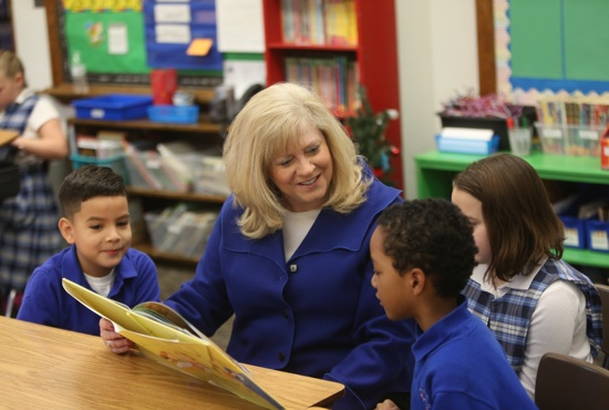 Jane Bona, principal of Immaculate Conception School in Columbia Heights, reads to children Jan. 28. Bona will receive the