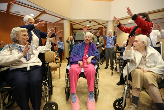 Sister Mary Mark Mahoney, center, receives a blessing in the chapel of Carondelet Village in St. Paul during a surprise party to celebrate her 105th birthday Jan. 11. She is a retired St. Joseph Sister of Carondelet who lives at Carondelet Village. Dave Hrbacek/The Catholic Spirit