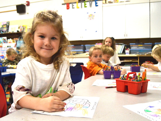 Preschooler Madilyn Terpstra looks up from her coloring work at St. Dominic School in Northfield. Bob Zyskowski/The Catholic Spirit
