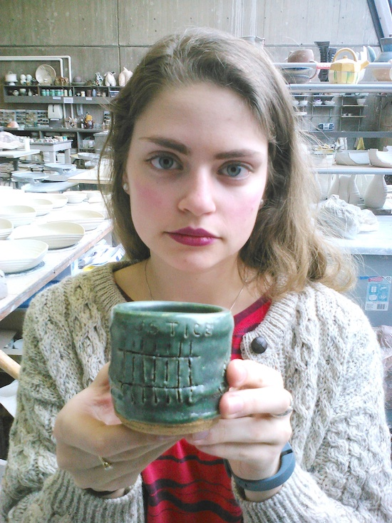 Lizzie Cleary holds one of the tea cups that will be part of an art installation at first the St. Paul campus and then the Minneapolis campus of St. Catherine University. The cup was made by Cleary, a studio art major, but it was decorated by someone with personal experience of domestic violence. Bob Zyskowski/The Catholic Spirit