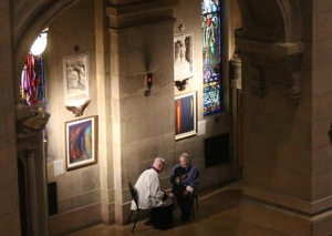 A priest hears a confession at the Basilica of St. Mary in Minneapolis March 4 at the start of 24 Hours for the Lord. Dave Hrbacek/The Catholic Spirit