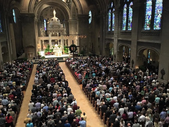 Basilica of St. Mary added hundreds of extra chairs for Masses on Easter, but their were still scores who had to stand at the 9:30 a.m. Mass. Dave Hrbacek/The Catholic Spirit