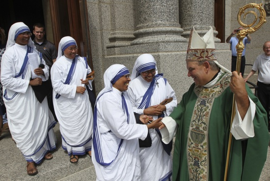 "Missionaries of Charity sisters greet Archbishop Bernard Hebda outside the Cathedral after Mass. In his homily, Archbishop Hebda said he'll say the prayer of Cardinal John Henry Newman that the sisters recite daily, asking Jesus to ""shine through me and be so in me that every soul I come in contact with may feel your presence in my soul."" Dave Hrbacek/The Catholic Spirit"