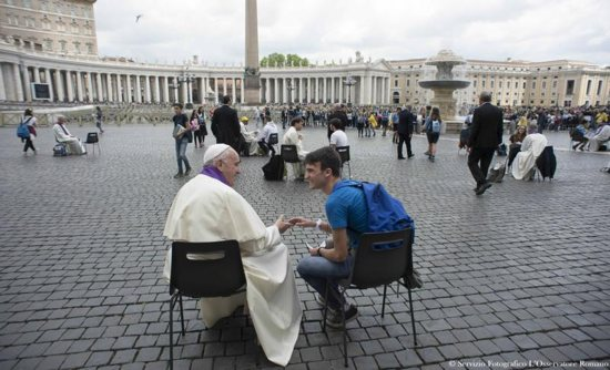 Pope Francis hears confession of a youth April 23 in St. Peter's Square at the Vatican. CNS photo/L'Osservatore Romano via Reuters