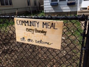 A sign outside of the Rye House announces its weekly community dinners. Maria Wiering/The Catholic Spirit