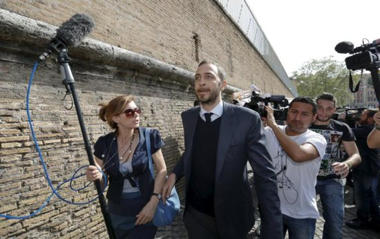 Journalist Emiliano Fittipaldi walks to his trial April 6 at the Vatican. CNS photo/Remo Casilli, Reuters