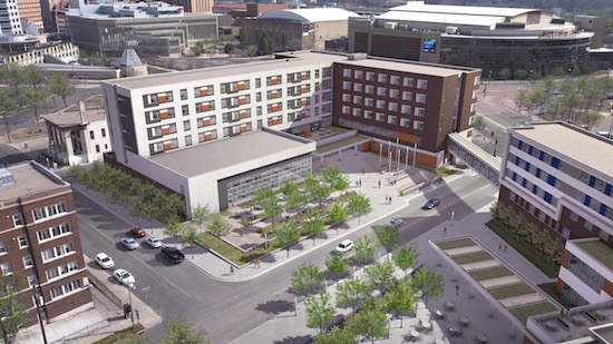 With downtown St. Paul in the background, the is is an artist's rendering of the new Higher Ground St. Paul under construction, an expansion of Catholic Charities' Dorothy Day Center. At right is the planned second phase of the project, the St. Paul Opportunity Center with services provided on the first floor and the Dorothy Day Residence on the second.