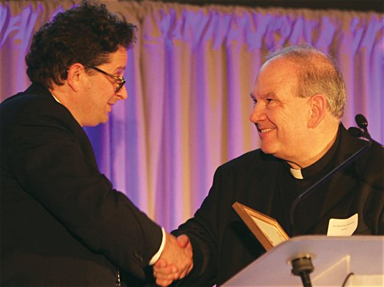 """Archbishop Bernard Hebda greets Steve Hunegs, executive director of the Jewish Community Relations Council of Minnesota and the Dakotas, during a Dec. 2, 2015, event in Minneapolis commemorating the 50th anniversary of the Vatican II document """"Nostra Aetate."""" Dave Hrbacek/The Catholic Spirit"""