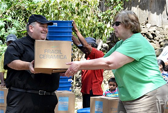 As part of a sister-diocese project of the Diocese of Gaylord, then-Bishop Hebda helps deliver water filters to families in a remote area of the Diocese of Matagalpa, Nicaragua. Courtesy the Diocese of Gaylord