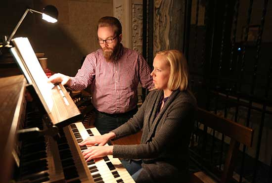 From left, organists Joel Kumro of Our Lady of Peace in Minneapolis and Anne Phillips of Epiphany in Coon Rapids practice at the Basilica of St. Mary in Minneapolis. Both are organists and music directors at their parishes. Dave Hrbacek/The Catholic Spirit