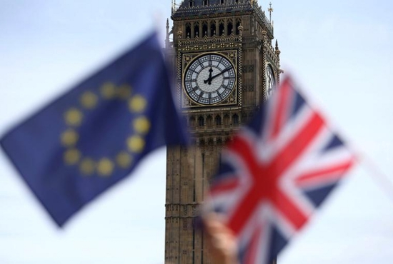 A European Union flag and British Union flag are seen at Parliament Square in London June 19. Voters in the United Kingdom voted June 23 to leave the European Union. CNS photo/Neil Hall, Reuters