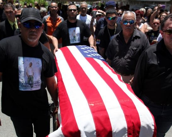 Pallbearers carry the coffin of Angel Candelairo Padro during his funeral June 18 in his hometown of Guanica, Puerto Rico. Candelario was of the victims of the June 12 mass shooting at the Pulse nightclub in Orlando, Fla. CNS photo/Alvin Baez, Reuters