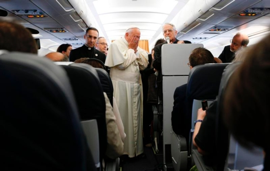 Pope Francis wipes his eyes as he meets journalists aboard his flight from Rome to Yerevan, Armenia, June 24. The pope was beginning a three-day visit to Armenia. CNS photo/Paul Haring