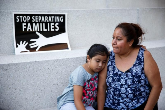 A mother and daughter in Los Angeles react after the U.S. Supreme Court issued a split ruling June 23 blocking President Barack Obama's executive actions to temporarily stop deportations. CNS photo/Eugene Garcia, EPA)