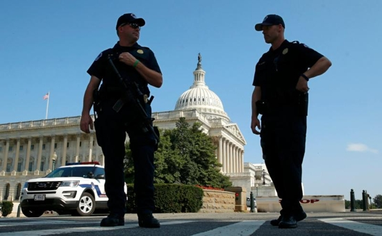 U.S. Capitol Police officers stand outside the Capitol July 8 in Washington. In a bipartisan 245-182 vote, House members July 13 passed the Conscience Protection Act, which would provide legal protection to doctors, nurses, hospitals and all health care providers who choose not to provide abortions as part of their health care practice. CNS photo/Kevin Lamarque, Reuters