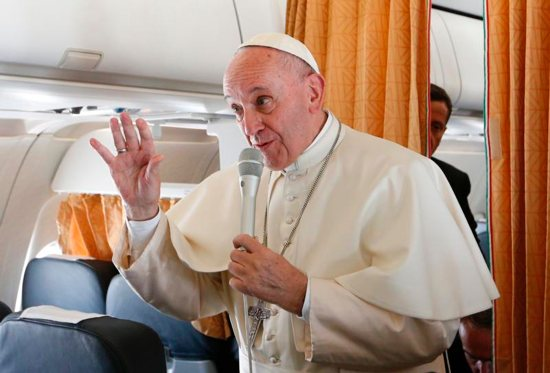 Pope Francis gestures as he speaks to journalists aboard his flight from Rome to Krakow, Poland, July 27. The pope is attending World Youth Day in Krakow. CNS photo/Paul Haring