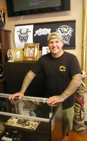 Kurt Deetjen is seen inside Above All Tattoo in San Diego, where he works as a tattoo artist. He is an active parishioner of nearby St. Brigid Parish, where he is involved in several ministries, including the parish's outreach to homeless people. CNS photo/Denis Grasska, The Southern Cross