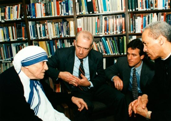 In this 1996 file photo, Blessed Teresa of Kolkata visits Catholic Relief Services headquarters in Baltimore, Md, accompanied by Ken Hackett, center, U.S. ambassador to the Holy See and former president of CRS, Sean Callahan and Bishop John H. Ricard of Pensacola-Tallahassee, Fla. CNS photo/courtesy Catholic Relief Services