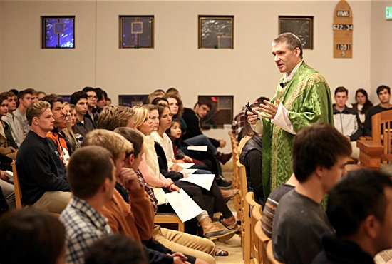 Father Michael Becker delivers the homily during Sunday evening Mass Oct. 9 at  St. John Vianney College Seminary in St. Paul.  Dave Hrbacek/ The Catholic Spirit