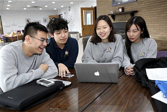 From left, Totino-Grace High School juniors Frank Chen, Calisto Zhang, Avelyn Lee and Olivia Song study in the residence where they live on campus in Fridley. Lee is from Korea, and the others are from China. Dave Hrbacek/ The Catholic Spirit