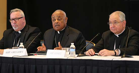 Atlanta Archbishop Wilton Gregory, center, speaks during a news conference Nov. 14 during the annual fall general assembly of the U.S. Conference of Catholic Bishops in Baltimore. At left is Bishop Christopher Coyne of Burlington, Vermont and at right is Archbishop Jose Gomez of Los Angeles. CNS/Bob Roller