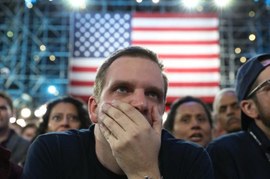 People react to election results at the Jacob K. Javits Convention Center in New York City Nov. 8. CNS photo/Andrew Gombert, EPA