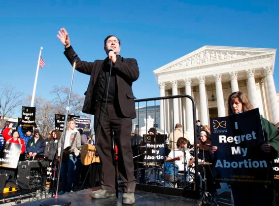 Father Frank Pavone, national director of Priests for Life, speaks in front of the U.S. Supreme Court at the 2009 March For Life in Washington. Pro-life supporters have denounced Father Pavone over a controversial election Facebook Live video he posted. CNS photo/Bob Roller