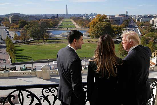 U.S. House Speaker Paul Ryan, R-Wis., shows Melania Trump and U.S. President-elect Donald Trump the Mall from his balcony on Capitol Hill in Washington Nov. 10. CNS/Joshua Roberts, Reuters