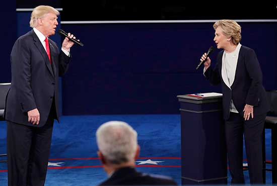 Republican U.S. presidential nominee Donald Trump and Democratic presidential nominee Hillary Clinton speak during their Oct. 9 presidential town hall debate at Washington University in St. Louis. CNS/Jim Young, Reuters