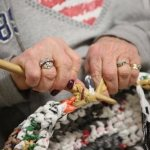 Crocheting sleeping mats a two-fold service for Most Holy Redeemer 'Bag Ladies'