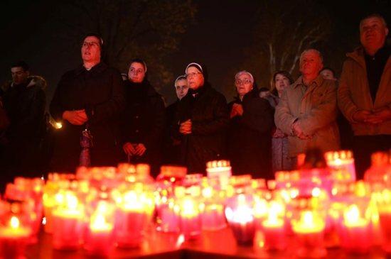 People praying in Croatia