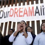 Federal judge puts temporary block on Trump's decision to end DACA