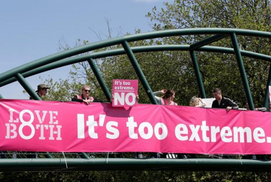 Protesters hold up banners on a bridge in Dublin to persuade voters as Ireland holds a referendum on its law on abortion.