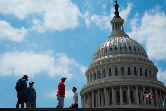 People are seen near the U.S. Capitol in Washington