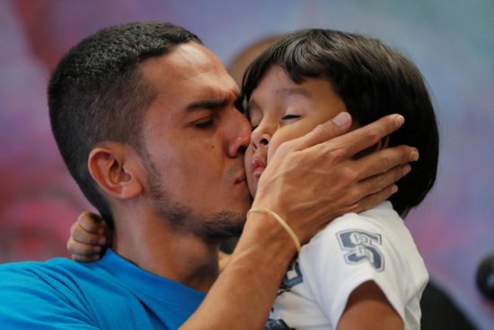 Javier, a 30-year-old immigrant from Honduras, kisses his 4-year-old son, William, July 11 in New York when they were reunited after being separated for 55 days during detention at the Texas border.
