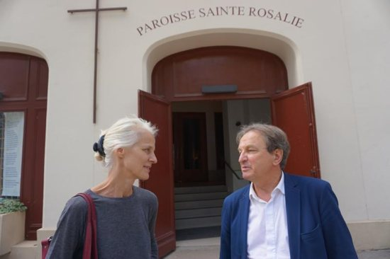 Jerome Perrin, president of the Society of St. Vincent de Paul in Paris and a leader in coordinating Catholic aid to refugees, talks with colleague, Anne de Buffevent