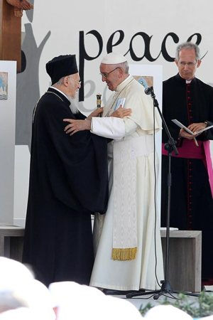 Pope Francis greets Ecumenical Patriarch Bartholomew of Constantinople during an ecumenical prayer service on the waterfront in Bari, Italy