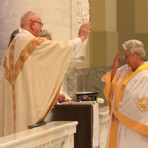 Father Edward Lamp blesses the Catholic Daughters' National Regent-Elect Sherry Nilles during her July 21 installation Mass at St. Joseph Cathedral in Sioux Falls, S.D.