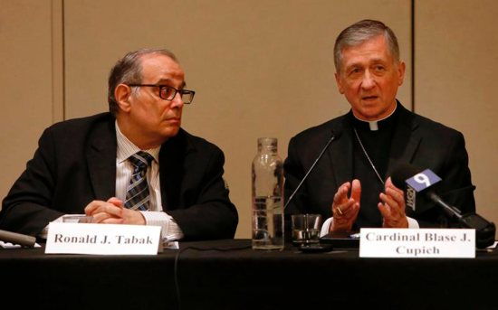Ronald Tabak, chair of the death penalty committee of the American Bar Association's Section of Civil Rights and Social Justice, listens as Cardinal Blase Cupich of Chicago talks about the death penalty Aug. 2 during a panel discussion in Chicago. Cardinal Cupich spoke about how Catholic teaching on the death penalty has developed.