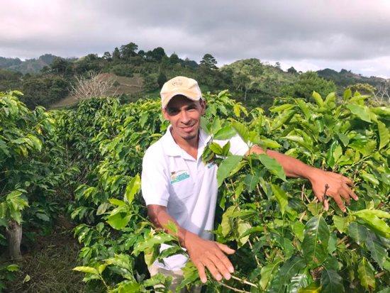 Moises Garc'a poses for a photo on a coffee farm Zapote, Honduras
