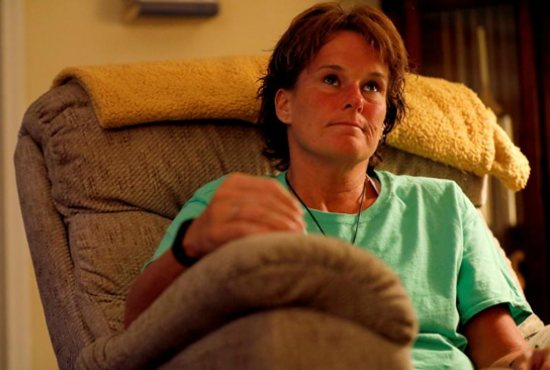 Mary McHale, an alleged victim of sexual abuse by a clergy member, pauses during an Aug. 18 interview in Reading, Pa.
