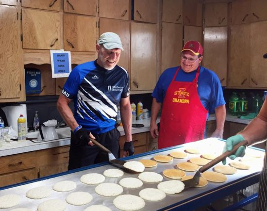 Bishop Thomas Zinkula of Davenport, Iowa, flips pancakes July 27 at the Knights of Columbus breakfast in Harper during RAGBRAI, an annual noncompetitive bike ride across Iowa organized by The Des Moines Register daily newspaper.