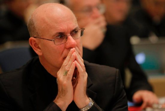 Bishop Kevin Rhoades of Fort Wayne-South Bend, Ind., listens to speakers Nov. 16 during the opening of the 2015 fall general assembly of the U.S. Conference of Catholic Bishops in Baltimore.