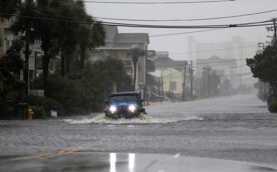 A vehicle navigates a flooded road Sept. 14 during Hurricane Florence in North Myrtle Beach, S.C. The storm is poised to affect more than 10 million people in the southeastern U.S.